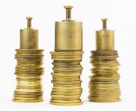 Calibration weights on coins Royalty Free Stock Photo