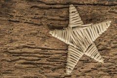 Calibre avec l'étoile en bois Photographie stock libre de droits
