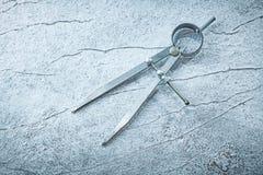 Calibre de glissière sur le concept métallique de construction de fond Images libres de droits