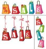 Calibre de vente avec des sacs de cadeau Photos stock