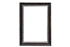 Calibre en bois de cadre de photo vide d'isolement sur le mur Photographie stock libre de droits