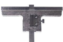 Calibro di profondità per la misurazione dell'altezza delle cavità su un isolato bianco del fondo immagini stock