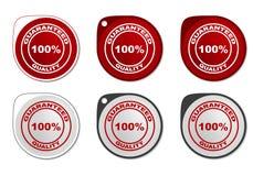 Calidad garantizada alrededor de etiqueta engomada Foto de archivo