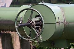 Caliduct valve wheel - heat pipeline. Photo of heat pipeline valve wheel with chain and lock Stock Photos