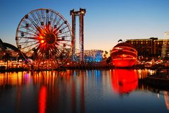 California Adventure at Night. The Ferris wheel and other rides of Disney`s California Adventure glow against the dusk sky Royalty Free Stock Photos