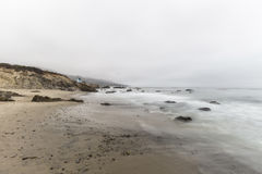 California Beach with Motion Blur Water in Malibu. Leo Carrillo State Beach with motion blur water and clouds in Malibu, California Royalty Free Stock Image