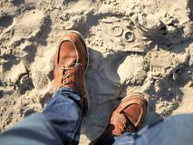 California beach shot of my boots in the sand. For travel blogs as a banner image, graphic, social media post with copy space. California beach shot of my boots Royalty Free Stock Images