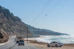 California beaches and highway near Los Angeles city with a clear blue sky and yellow sand on the coast Stock Photography