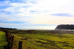 California highway 1 one Pacific ocean. California blue sky on the coast near big sur fence green grass stock photo