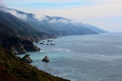 California highway 1 one Pacific ocean. California blue sky on the coast near big sur mountains stock images