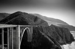 California Bridge. A seaside bridge spans over mountainous terrain in California Stock Photo