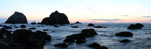 California Coast. Northern California coast beach in the early summer at sunset in panoramic Royalty Free Stock Photo