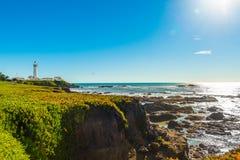 California coast lighthouse. Benches facing the coastline in route 1 California , USA Royalty Free Stock Photos