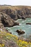 California Coastal Cliffs. Treacherous waters swirl at the base of these California sea cliffs Royalty Free Stock Photography