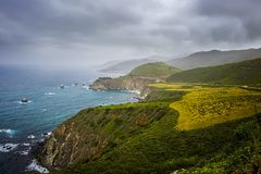 California Coastal Landscape and Seascape along Highway 1. California coastal land and seascape on iconic Highway 1 with bridge in distance royalty free stock image