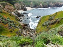 California Coastal Rocks and Cliffs, Rippling Water Surface - Road Trip down Highway 1. Waves of the Pacific ocean crashing against the rocks of the Californian stock image