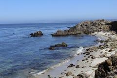 California coastline rocks sand Royalty Free Stock Photography