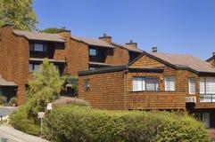 California condo 1. Brown shingle California condominium under blue summer skies in Marin County, Bay Area Royalty Free Stock Images