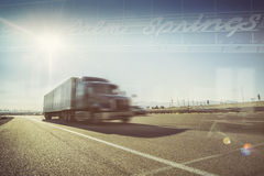 California desert trucking Palm Springs. California desert trucking - Double exposure image - Truck on Highway i10 passing through Palm Springs Mohave desert Stock Photo