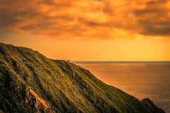 California dreaming. Beautiful view from the cliffs of the Pacific coast highway, gorgeous light before sunset. Somewhere on the cliffs is a couple overlooking royalty free stock photo