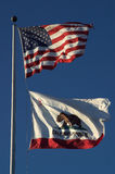 California flag. Flag of the state of California (underneath the US flag royalty free stock photos