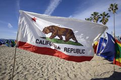 California Flag on the beach. Promoting world peace. Other countries of the world are on display in the background stock images