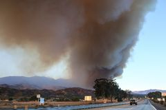 Cars driving on Highway 101, huge wildfire smoke view. California has declared a state of emergency as wildfires burn outside Los Angeles royalty free stock images