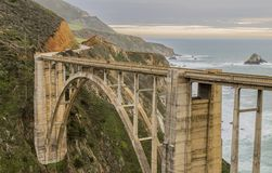 Bridge next to Pacific Ocean - mountains in the background - on highway 1 california usa stock photos