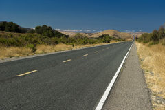 California Highway into the Horizon. California Highway stretching into the Horizon royalty free stock images