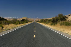 California Highway into the Horizon. California Highway stretching into the Horizon royalty free stock photo