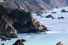California highway 1 one Pacific ocean. California blue sky on the coast near big sur mountains royalty free stock images