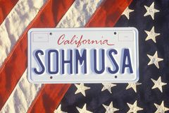California License Plate �Sohm USA� Lying on American Flag, United States Stock Image