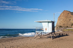 California lifeguard post on sandy beach. Blue lifeguard hut on Sycamore Canyon beach in Southern California Royalty Free Stock Images