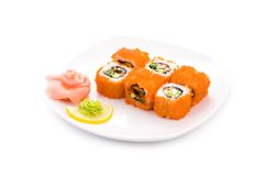California maki. Image of California maki sushi rolls in red caviar served with pickled ginger and wasabi stock photos