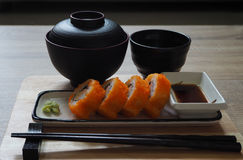 California maki roll in square plate Japanese style served with shoyu sauce and wasabi. On table wood Stock Photo