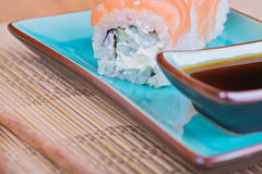California maki sushi with fish on azul plate Royalty Free Stock Photos