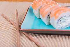 California maki sushi with fish and chopsticks Stock Images