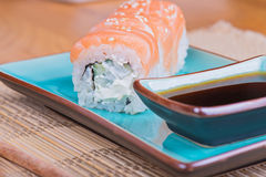 California maki sushi with fish and soy sauce Stock Photo