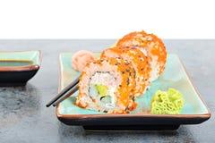 California maki sushi with masago and ginger Stock Photo
