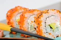 California maki sushi with orange masago Royalty Free Stock Photos