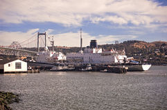 California Maritime Academy. This is a picture of the California Maritime Academy's dock and training ship, the Golden Bear, and other smaller ships.  The Royalty Free Stock Photo