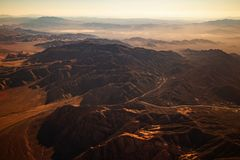 Beautiful mountains and road with sun light, aerial view from airplane, Las vegas stock image