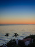 California. Night sky over ocean, bright orange color after sunset. Foreground of  California coast, not far from Santa Barbara. In  shadow of  evening to see Royalty Free Stock Photos