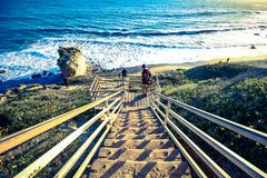 Stairway down to malibu beach. California ocean view with rock and waves from the top of stairs with hand railing Stock Image