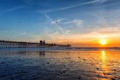 California Oceanside pier at sunset. California Oceanside pier over the ocean at sunset with beach, travel destination Royalty Free Stock Photos