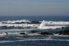 California Pacific Ocean Waves on Rocks. Pacific Ocean horizon with waves splashing on rocks at Fort Bragg, California stock photos