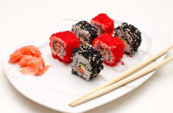 California and Philadelphia rolls. With chopsticks on the plate Stock Image