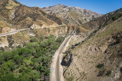 California Railroad Tracks. Line of California railroad tracks leads around a mountain bend into a train tunnel Stock Photography