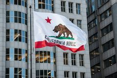 California Republic flag with grizzly bear raised in city downtown.  stock photos