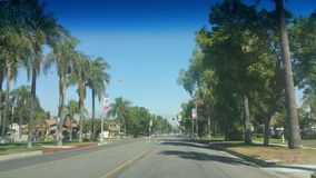 California Road. Mountain in the distance from a beautiful palm tree lined road stock images